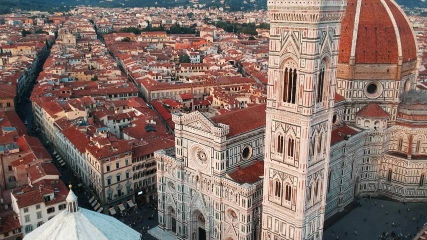 Aerial drone close up view of Florence Cathedral, Cattedrale di Santa Maria del Fiore in Firenze, Florence, Italy on a sunny day | Shutterstock HD Video #1052884760