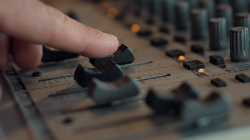 Soundboard Pads On TV Station.Sound Designer Used Digital Audio Mixer In Production Studio.Sound Engineer Moving Sliders In Radio Station.Engineer Press Key Buttons On Control Desk Recording Studio. | Shutterstock HD Video #1052887223