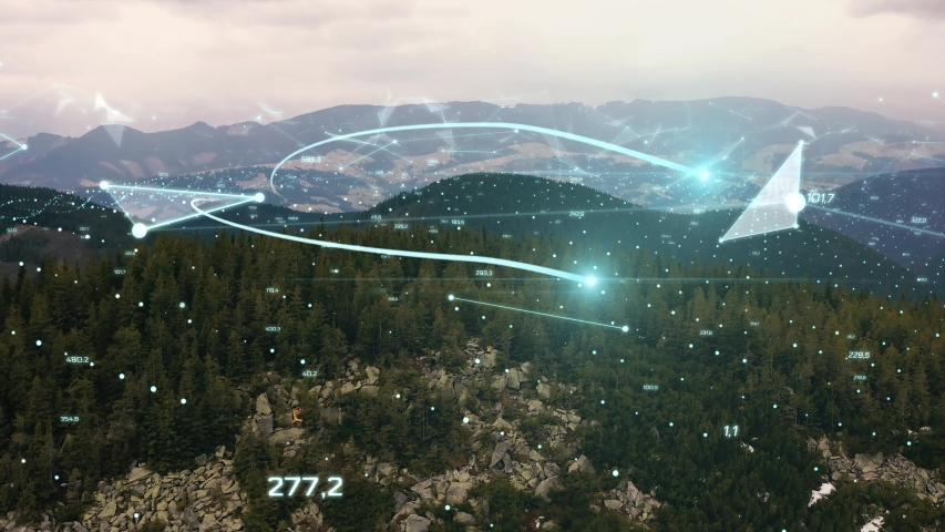 Visualization of Information Flows and Lines Flying from Mobile Phone into Global Network. Aerial Drone Shot. young woman standing on on a rock on top of a mountain Royalty-Free Stock Footage #1052893112