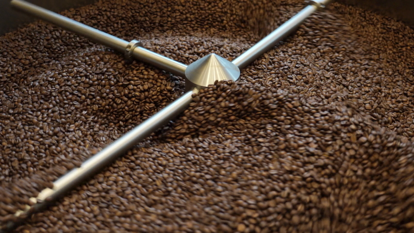 Roasting coffee beans in a commercial coffee roaster | Shutterstock HD Video #1052893430