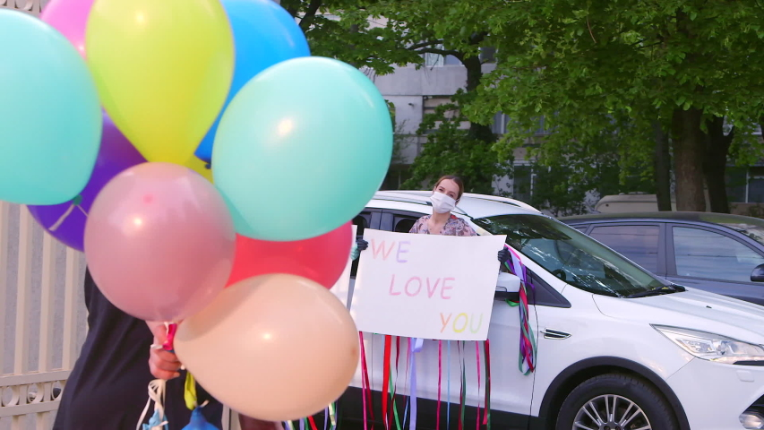 Birthday Surprise Women Girls Party Reception Baloons Car Keeping Social Distancing During Pandemic Coronavirus, Covid-19. Colorful Handwritten Message on Cardboard.
