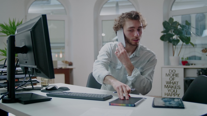 Young Attractive Professional Designer Make Phone Call at Work. Positive Vibes. | Shutterstock HD Video #1052899544