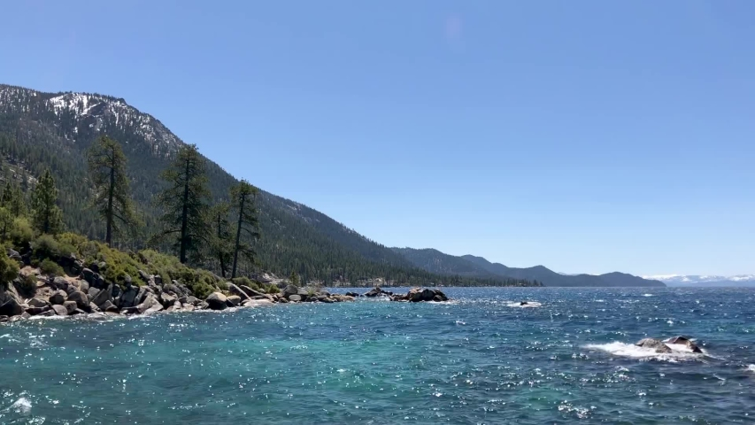 Mountains rising above Lake Tahoe's clear blue waters.