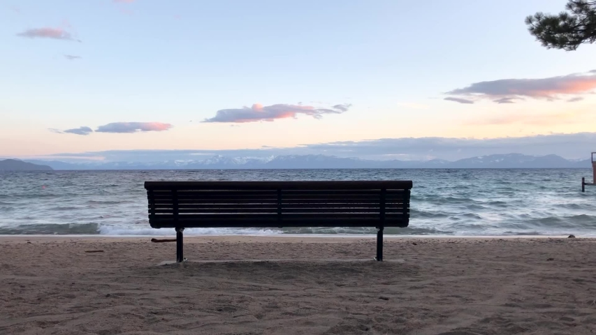 A lone bench at the water's edge on a beautiful evening in Incline Village, Nevada on the north shore of Lake Tahoe.