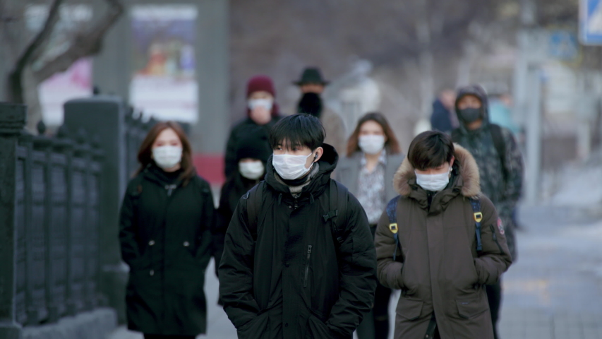 Asian people go walk. Asia corona virus mers. City street outdoor. Covid-19. Chinese man in face mask public. Epidemic coronavirus. Masked crowd quarantine. Pandemic corona virus. Covid 19 china. Royalty-Free Stock Footage #1052907206