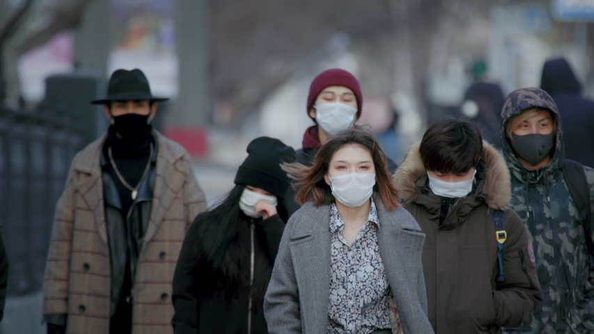 Asia Infect Corona Virus Mers. Face Mask Covid-19 Chinese Public. Epidemic Coronavirus Asian Ill Man go walk. Pandemic Corona Virus. Crowd Masked Lockdown. People Sick Covid 19. China coronavirus Mers Royalty-Free Stock Footage #1052907209