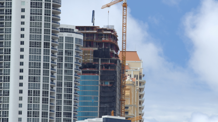 Highrise buildings under construction Sunny Isles Beach FL 6k video shot on blackmagic braw camera | Shutterstock HD Video #1052911748