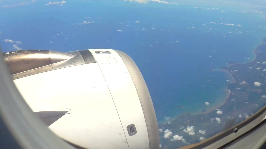 A beautiful view from the plane window overlooking Gulf of Thailand | Shutterstock HD Video #1052913785