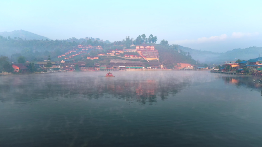 Aerial drone sky view flying in misty morning at Ban Rak Thai, a Chinese settlement in Mae Hong Son province, Northern Thailand. | Shutterstock HD Video #1052920895