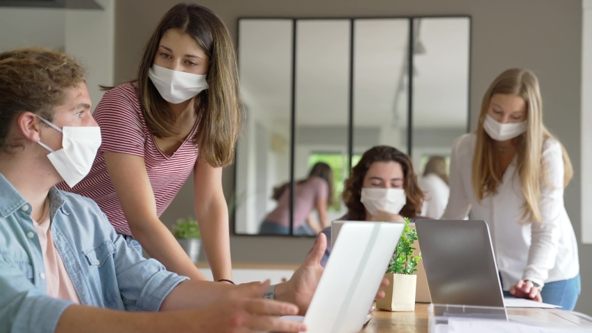 Group of students working wearing masks | Shutterstock HD Video #1052921099