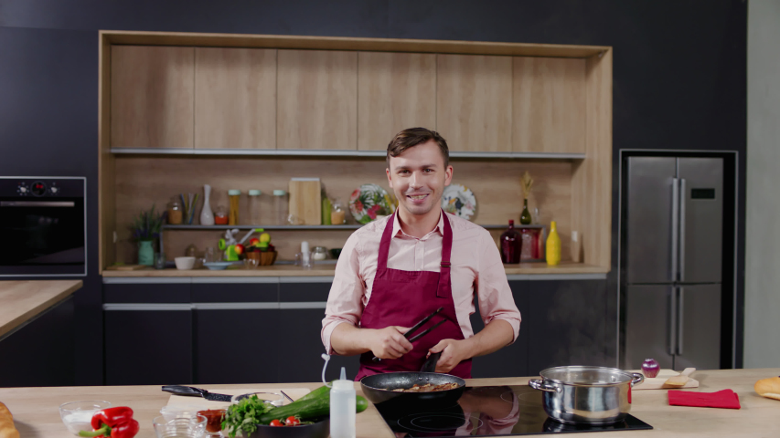 Cooking show hosts celebrity chef shows how to cook meat. Morning TV cooking programme. Shot on ARRI Alexa Mini Royalty-Free Stock Footage #1052921948