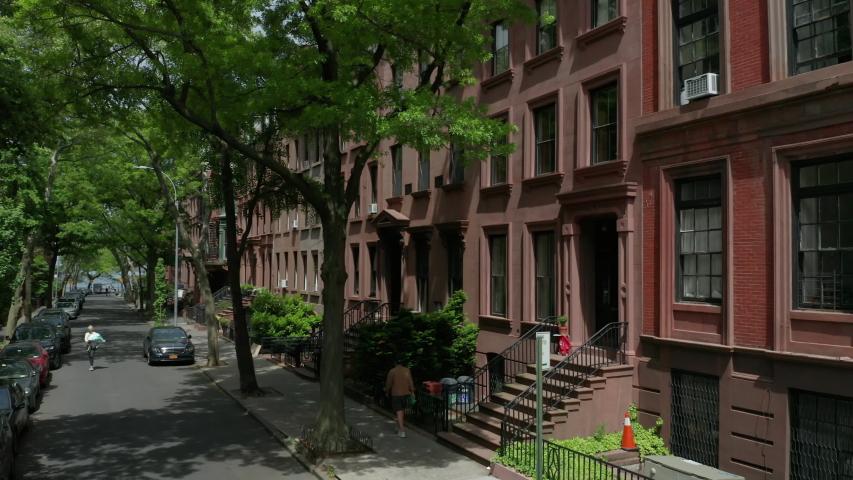 Rising over brownstone block in Brooklyn Heights revealing NYC skyline | Shutterstock HD Video #1052956589