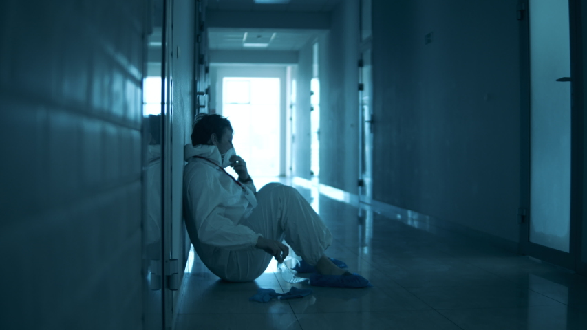 Doctor is sliding down the wall while being exhausted Royalty-Free Stock Footage #1052956826
