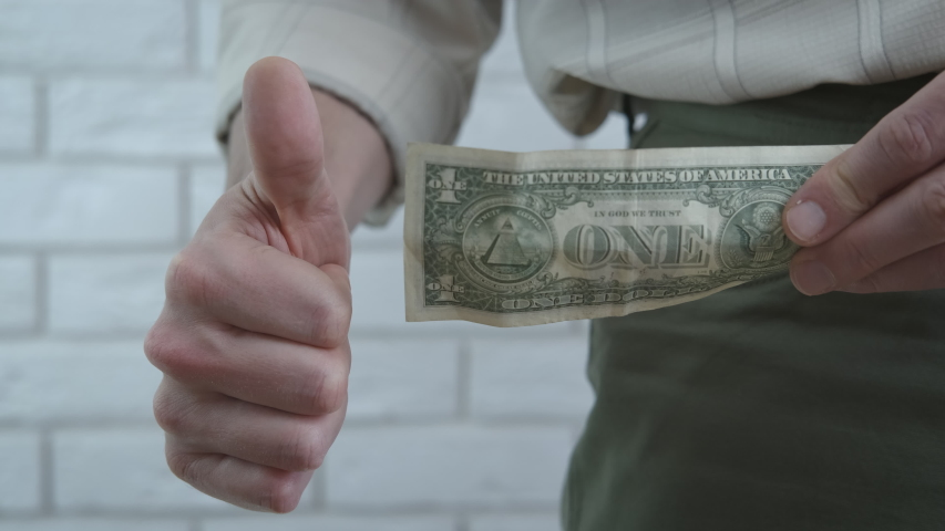 Salary crisis. A man show a dollar from his pocket in the room. A concept of salary crisis in the world.   Shutterstock HD Video #1052960048