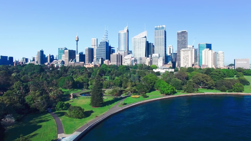 Sydney Royal Botanic Garden and city skyline on a beautiful sunny morning, slow motion aerial view.   Shutterstock HD Video #1052975450