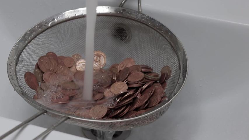 Wash money under the tap | Shutterstock HD Video #1052985035