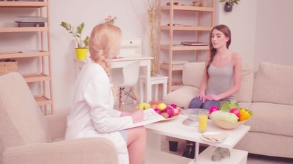 Nutritionist consulting client in the clinic. Girl with low weight problem visiting doctor to have health problem tests. Proper nutrition concept. Tone video. Prores 422.