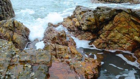Ocean water hitting the rocks, close shot,indian beach, goa,india