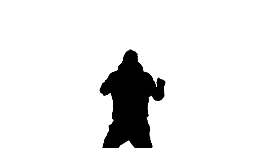 Medium long shot of young handsome man dancing hip hop, freestyle, street dance, black silhouette on a white background | Shutterstock HD Video #1052995100