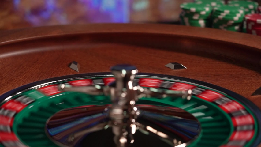 Man playing at the Roulette table  at the Casino - Selective Focus | Shutterstock HD Video #1052998031