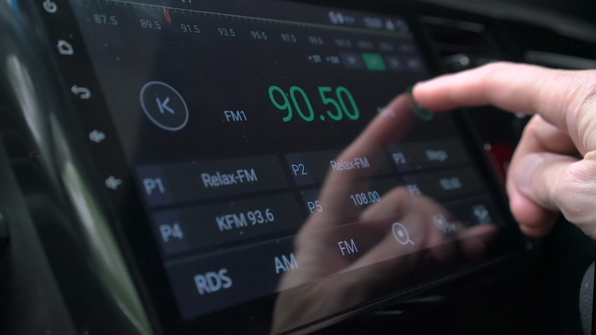 Man finger changing radio stations using smart multimedia touchscreen system for automobile, modern touch screen audio stereo system, transportation and vehicle concept, close up with selective focus Royalty-Free Stock Footage #1052999549