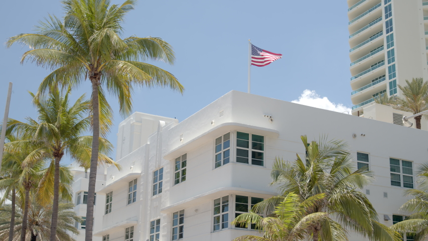 6k video buildings and palm trees with American Flag Miami Fort Lauderdale scene Royalty-Free Stock Footage #1053003809