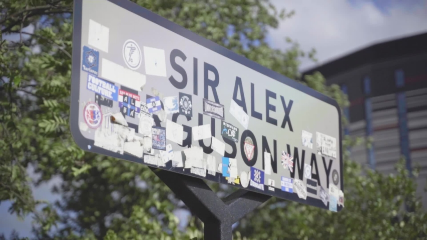 Manchester / UK - May 22 2020: Sir Alex Ferguson Way street sign near Manchester United's Old Trafford Stadium in Manchester