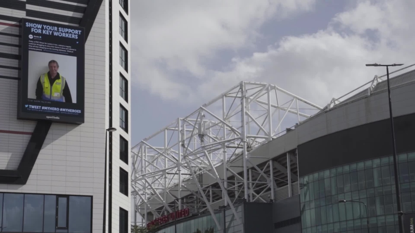Manchester / UK - May 22 2020: Catch it, Bin it, Kill it, and support key worker signs shown outside Manchester United's Old Trafford Football Stadium during the coronavirus covid-19 pandemic