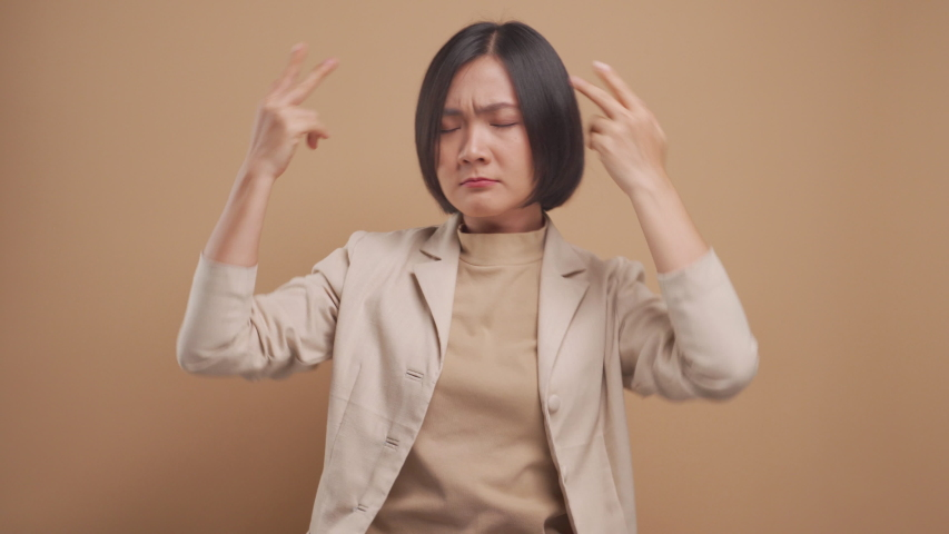 Asian business woman happy relax and dancing isolated over beige background. 4K video | Shutterstock HD Video #1053026171