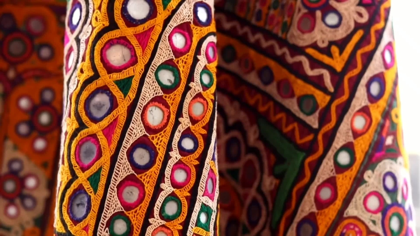 Embroidery designer & female in Indian traditional type pattern sewing embroidery pattern close up view,Hands of senior woman, needlework,selective focus without noise | Shutterstock HD Video #1053032294