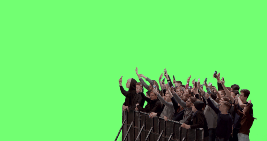 GREEN SCREEN CHROMA KEY Model released, Front view of huge crowd dancing and cheering at a concert or a show behind control barrier. Shot on RED Helium 8K Prores 4444 | Shutterstock HD Video #1053038450