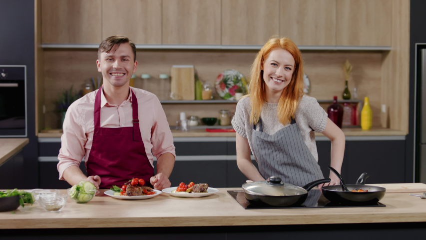 Cooking show hosts finishing cooking show and saying goodbye to the audience. Morning TV cooking programme. Shot on ARRI Alexa Mini Royalty-Free Stock Footage #1053038492