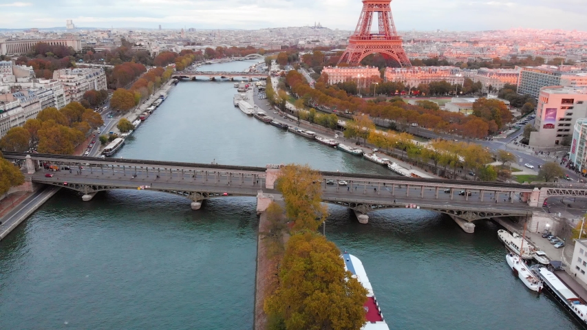 Aerial drone distant sunset view of Tour Eiffel Tower and Seine River, Paris city attractions, in France  | Shutterstock HD Video #1053042503