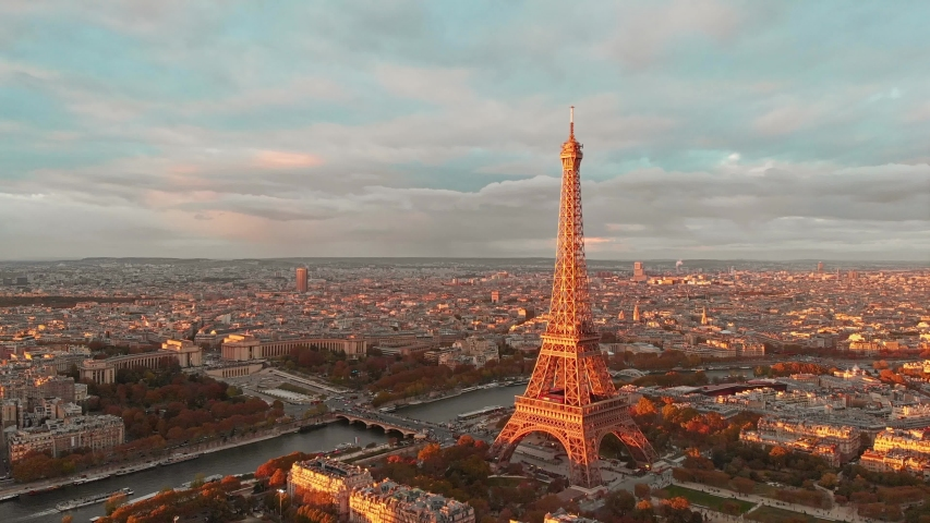 Aerial drone distant sunset view of Tour Eiffel Tower and Seine River, Paris city attractions, in France  | Shutterstock HD Video #1053042506