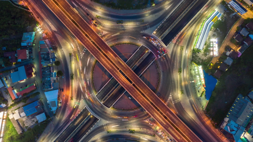 Time lapse Aerial view and top view of traffic on city streets in Bangkok , Thailand. Expressway with car lots. Beautiful roundabout road in the city center.   Shutterstock HD Video #1053059546