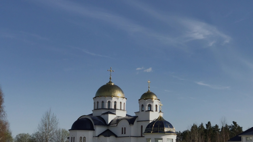 Beautiful church with golden domes against the sky. | Shutterstock HD Video #1053069089