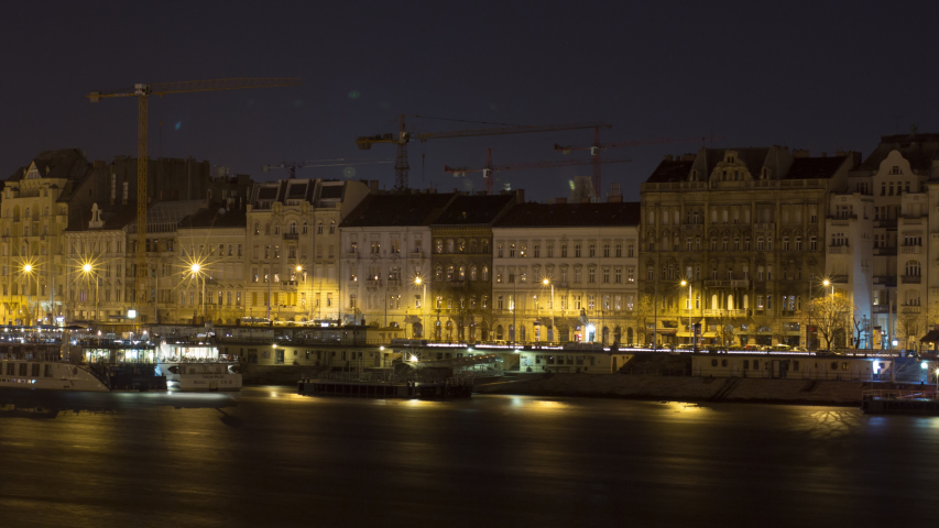 Long term Time-Lapse showing houses  along the Danube at Night in Budapest, Slow Tracking Shot | Shutterstock HD Video #1053070349