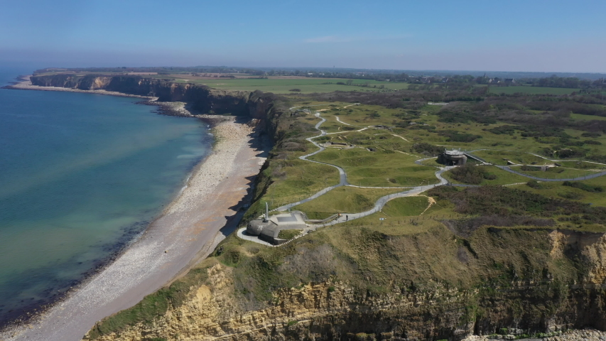 Aerial view of Pointe du Hoc on the coast of Normandy. famous World War II site | Shutterstock HD Video #1053088154