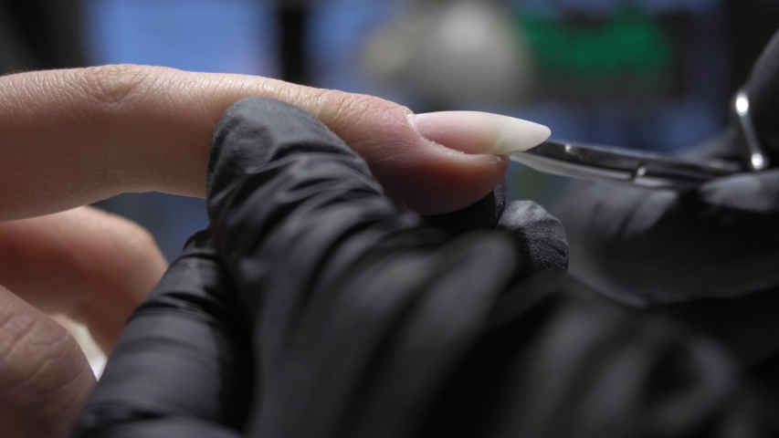 Manicurist makes  a manicure with professional tools for manicure. Manicure Nails service. | Shutterstock HD Video #1053092564