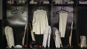 Cricket Changing room / Locker room. All the kit or uniform is laid out ready for the players. Tracking Shot Towards. Stock Video Clip Footage