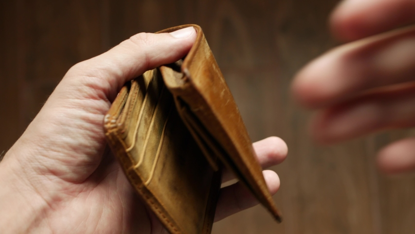 Man bankrupt arrears showing empty wallet with no money. Poverty finance business bankruptcy concept. Male debt businessman showing empty wallet. Financial crisis of getting into debt. no money on
