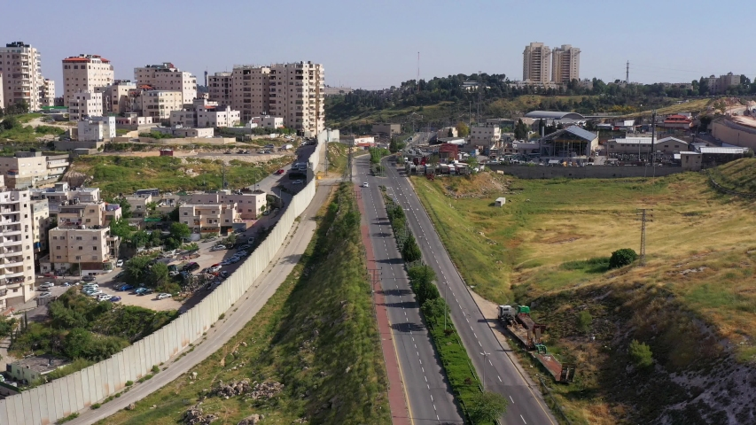 Shuafat Refugee Camp divided by security Wall from Israel- Aerial View Israel, Jerusalem- May/10,2020  | Shutterstock HD Video #1053097337