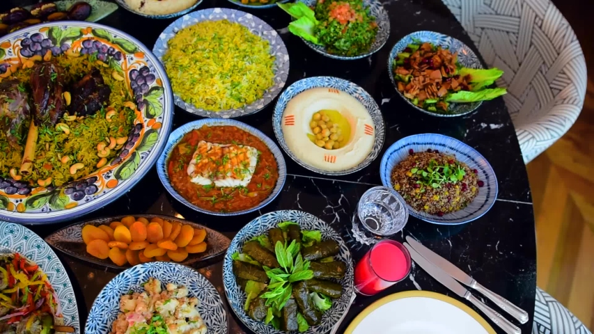 The Islamic holiday of Eid ul-Fitr marks the end of the Islamic fasting of the month of Ramadan.Traditional Eastern food and meal are on the table.
