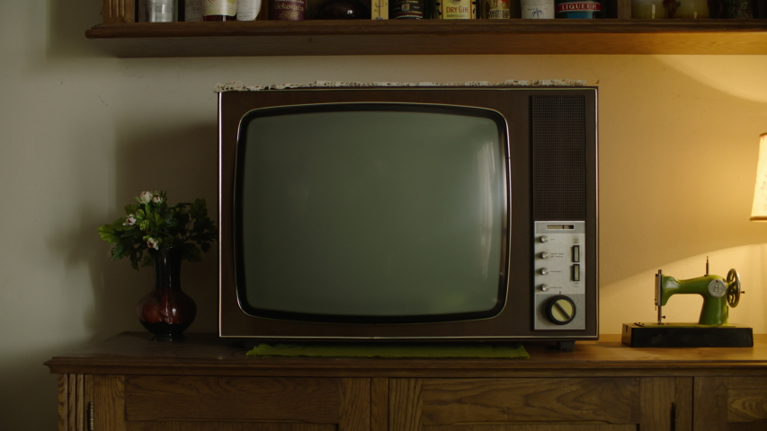 A Vintage Television In The Retro House. Old TV standing on an old table. Retro atmosphere.