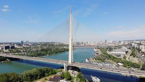 Aerial drone video of Ada bridge, a cable-stayed bridge over the Sava river in Belgrade, Serbia