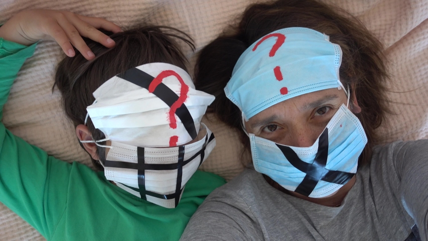 4K Covid-19 lockdown selfie - Protesting selfie of mother and child in impressional face masks  | Shutterstock HD Video #1053102995
