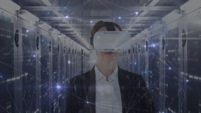 Animation of a Caucasian woman wearing a VR headset, touching a screen with connection icons floating in front of her. Global economy and technology concept digital composite | Shutterstock HD Video #1053111401