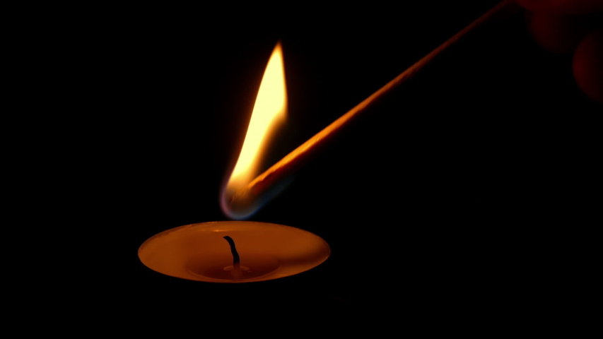 Man Lights Small Candle In Church It Burns And Is Blown Out | Shutterstock HD Video #1053114098