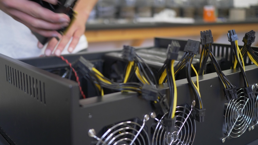 A employee putting videocards together | Shutterstock HD Video #1053117401