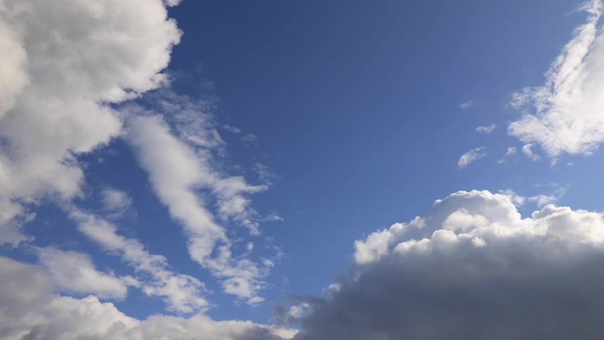 In the Blue Sky, clouds moving fast with the wind | Shutterstock HD Video #1053140798